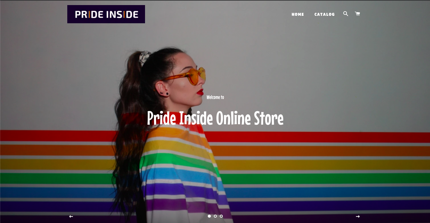 Pride Inside Online Store with an image of a woman with long wavy auburn hair in Pride themed jacket and sunglasses.